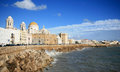 Cathedral of Cadiz along Atlantic Ocean, Spain Stock Images