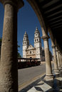 Cathedral of campeche in the main plaza of the city mexico seen from underneath an arch Stock Photo