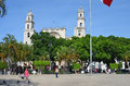 Cathedral and children in park merida chasing pigeons main square Royalty Free Stock Images