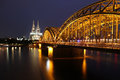 Cathedral of Cologne and iron bridge over Rhine river
