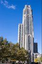 Cathedral of learning right towers over green and yellow trees against a deep blue sky in oakland a sub city pittsburgh Stock Photography