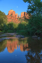 Cathedral rock moonrise reflection a dramatic scenic view of near sedona arizona at sunset with the full moon rising reflected in Stock Photos