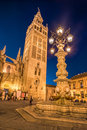 The cathedral of Seville and la Giralda by night, Spain Royalty Free Stock Photo