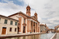 Catholic church in comacchio italy of san camillo near at the canal and an antique arch bridge ferrara Royalty Free Stock Image