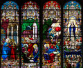 Catholic church four stained glass long windows Royalty Free Stock Photo