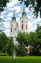 Catholic church in the green sombor threes Royalty Free Stock Photos