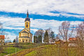 Catholic church on idyllic village hill Royalty Free Stock Photo