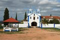 Catholic church in vila vicosa portugal whitewashed with blue trimming altantejo under cloudy sky Stock Photo