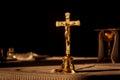 Catholic cross on altar in church lit by sunlight
