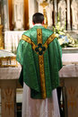 Catholic Priest facing altar Royalty Free Stock Photo