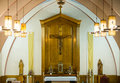 Catholic religious cross and altar inside a church Royalty Free Stock Photography