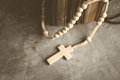 Catholic rosary beads with old book on cement table prayer, rosa