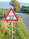 Cattle grid sign in northern England Royalty Free Stock Photo