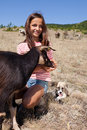 Cattle shepard girl shepherd feeding a goat in the bulgarian mountains Stock Photo