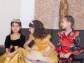Caucasian and asian children girls together at celebration christmas group of Stock Photos
