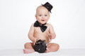 Caucasian baby boy plays with vintage camera an smiles joyfully Stock Image