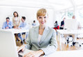 Caucasian Business Woman Smiling At The Camera While Working Royalty Free Stock Photo