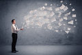 Caucasian businessman holding newspapers Royalty Free Stock Photo
