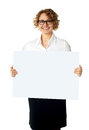 Caucasian businesswoman holding a blank billboard Royalty Free Stock Photo