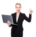 Caucasian businesswoman with laptop and thumb up Royalty Free Stock Photo