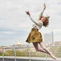 Caucasian fashion ballerina leaping on the roof Royalty Free Stock Photo