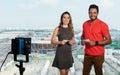 Caucasian female presenter and latin man at tv studio