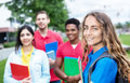 Caucasian female student with group of multiethnic students