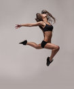Caucasian fitness woman jumping on white background Royalty Free Stock Photo
