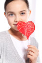 Caucasian girl with red valentine heart cute holding a Stock Images