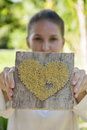 Caucasian girl showes heart with covered face Royalty Free Stock Photo