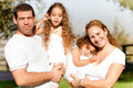 Caucasian happy family in the park Royalty Free Stock Image