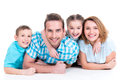 Caucasian happy smiling young family with two children Stock Photos
