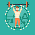 Caucasian hipster man lifting a heavy weight barbell. Royalty Free Stock Photo