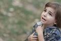 Caucasian little boy in a summer hat outdoors