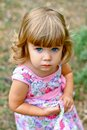 image photo : Caucasian little girl walking in the park