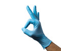 Caucasian male right hand in blue latex glove isolated over white background. Royalty Free Stock Photo