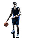 Caucasian man basketball player dribbling silhouette one in isolated white background Stock Photography