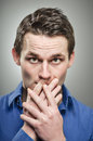 Caucasian man covering mouth with hands portrait a in his s his his Stock Photos