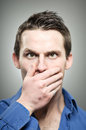 Caucasian man covering mouth with hands portrait a in his s his his Royalty Free Stock Photos