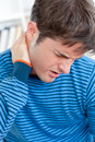Caucasian man having a neckache in the living-room Stock Images