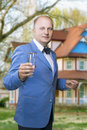 Caucasian man holding glass against new house portrait of vertical image Stock Image