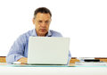 Caucasian man looking at his laptop computer portrait of a middle aged Royalty Free Stock Image