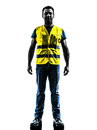 Caucasian man safety vest standing silhouette one in yellow isolated in white background Stock Photos
