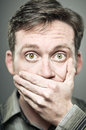 Caucasian man self censorship portrait a covering his mouth Royalty Free Stock Photos
