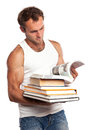 Caucasian man with a stack of books Stock Images