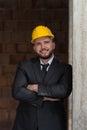 Caucasian manlig konstruktionschef with arms folded Fotografering för Bildbyråer