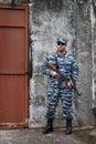 Caucasian military man with rifle in urban warfare black sunglasses holding near iron door Stock Photography