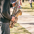 Caucasian musician entertaining people for money in park. Royalty Free Stock Photo