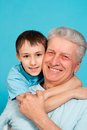 Caucasian old man with a youngster Stock Images
