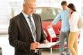Caucasian salesman in car showroom portrait of Stock Image